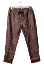 Punaruskeat coutatut housut